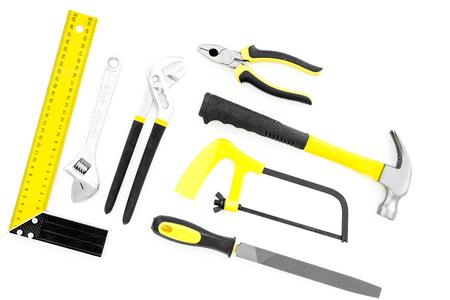 Repair tool kit. File, saw, hummer, corner ruler on white background top view.
