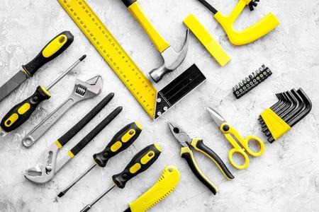 Various repair tools. Must-have for men. Equipment for building. Repair tool kit. Grey background top view pattern. Stok Fotoğraf