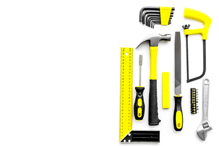 Various repair tools. Must-have for men. Equipment for building. White background top view copy space. Reklamní fotografie
