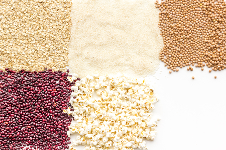 Various cereals, garnish background top view. Six squares