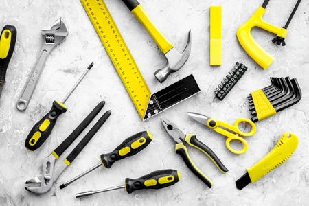 Various repair tools. Must-have for men. Equipment for building. Repair tool kit. Grey background top view pattern. Reklamní fotografie