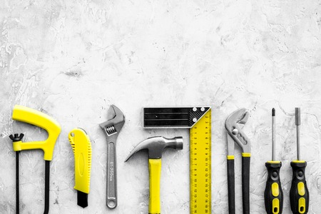 Various repair tools. Must-have for men. Equipment for building. Repair tool kit. Grey background top view pattern. Stock Photo
