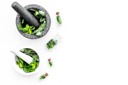 Phytotherapy. Herbs in mortar bowl on white background top view. Banco de Imagens - 95569272