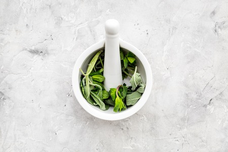 Phytotherapy. Herbs in mortar bowl on white background top view. Banco de Imagens - 95729643