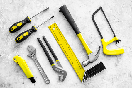 Various repair tools. Must-have for men. Equipment for building. Repair tool kit. Grey background top view pattern. Reklamní fotografie