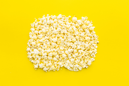 Popcorn moskup on yellow background top view copy space