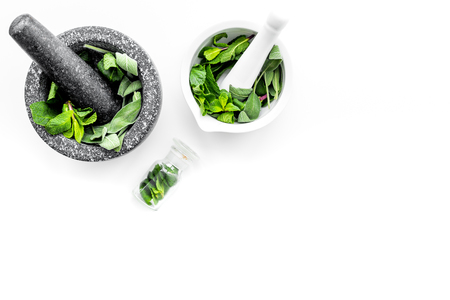 Phytotherapy. Herbs in mortar bowl on white background top view. Banco de Imagens - 95795546