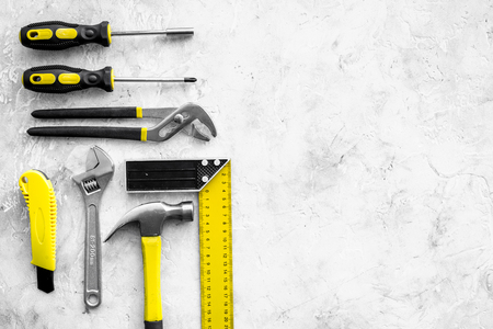 Various repair tools. Must-have for men. Equipment for building. Repair tool kit. Grey background top view pattern copy space