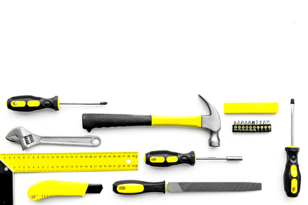 Various repair tools. Must-have for men. Equipment for building. White background top view copy space pattern