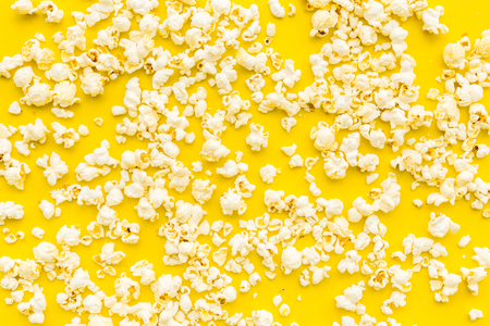 Popcorn background on yellow top view copy space. Stock Photo