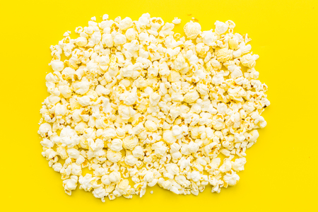 Popcorn moskup on yellow background top view copy space.