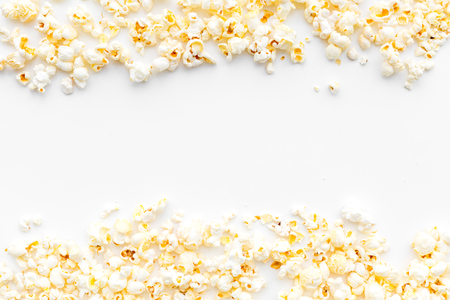Popcorn background on white top view copy space.