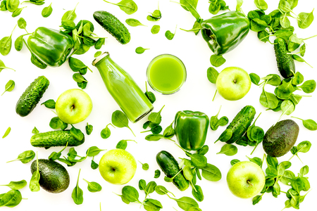 Green vegetables background. Shiny bell pepper and fresh apple on white background top view. 스톡 콘텐츠
