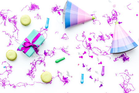 Birthday party accessories. Party hat, sweets, confetti on white background top view.
