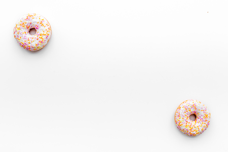 Unhealthy tasty sweets. Glazed donut on white background top view copy space Stock Photo