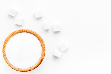 Types of sugar. White refined sugar on white background top view copy space