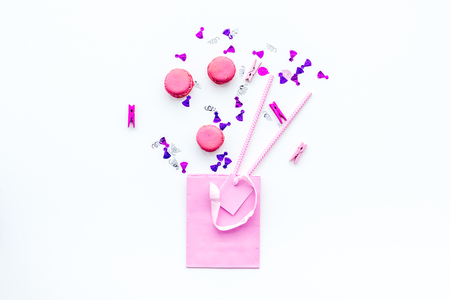 Gift concept. Sweets, paper bag for gift on white background top view copy space