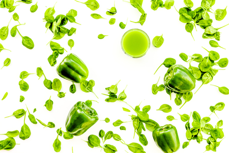 Green vegetables background with vegetable smoothies. Bell pepper, arugula salad on white background top view