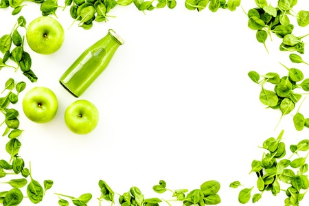 Green vegetables background with vegetable smoothies. Fresh apples, arugula salad on white background top view copy space
