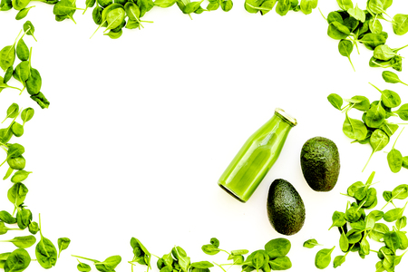 Green vegetables background with vegetable smoothies. Avocado, arugula salad on white background top view copy space