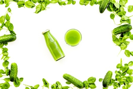 Green vegetables background with vegetable smoothies. Cucumber, arugula salad on white background top view copy space