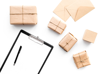 Parcel delivery concept. Wrapped boxes and pad on whote backgroyund top view mock up Stock Photo