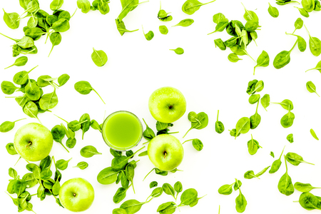 Green vegetables background with vegetable smoothies on white background top view.