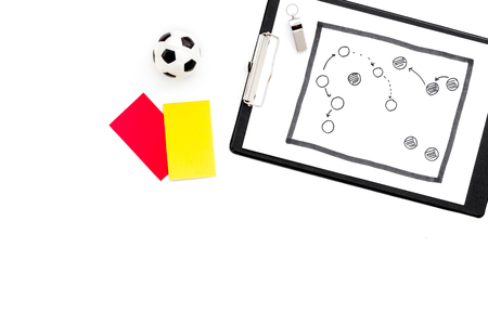 Sport judging concept. Soccer referee. Tactic plan for game, football ball, red and yellow cards, whistle on white background top view,