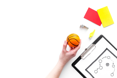 Sport judging concept. Referee. Tactic plan for game, basketball ball, red and yellow cards, whistle on white background top view.