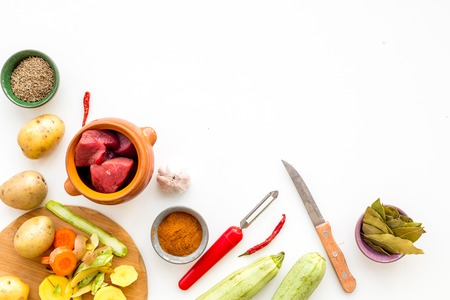 Traditional vegetable dish cooked in oven on white kitchen table background top view mock up