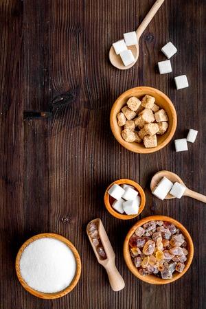 Sugar types. Different sugars on dark wooden background top view. Stok Fotoğraf