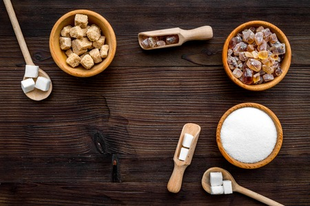 Sugar types. Different sugars on dark wooden background top view. Stok Fotoğraf