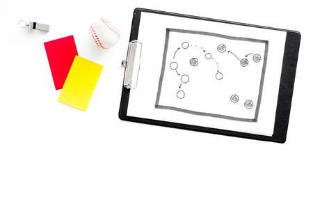 Sport judging concept. Soccer referee. Tactic plan for game, ball, red and yellow cards, whistle on white background top view. Stock Photo
