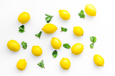 yellow citrus fruit set with lemons white background top view pattern