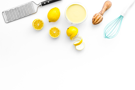 home kitchen table with yellow lemons for cooking citrus curd white background top view mock-up Фото со стока