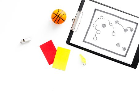 Sport judging concept. Referee. Tactic plan for game, basketball ball, red and yellow cards, whistle on white background top view copy space Stock Photo
