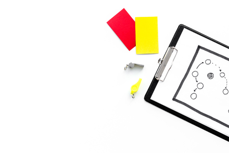 Sport judging concept. Referee. Tactic plan for game, red and yellow cards, whistle on white background top view copy space