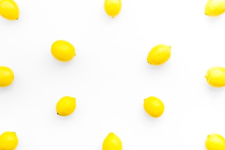 citrus pattern with yellow lemons on white background top view