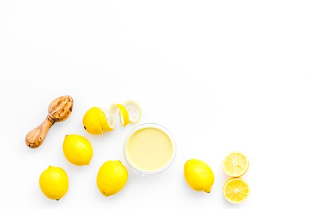 healthy sweet curd cooking with lemons on kitchen white background top view mock up Stock Photo