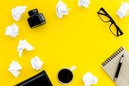 writer workplace with tools for work on yellow table background top view mockup Stock Photo - 97378947
