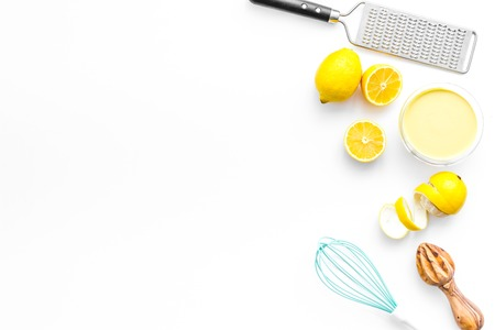 healthy sweet curd cooking with lemons on kitchen white background top view mock up Фото со стока