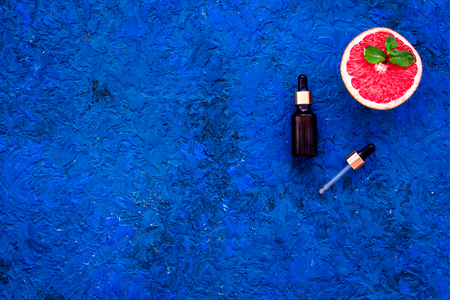 Homemade spa with grapefruit oil in natural cosmetic set fruit on blue background top view mock up Stock Photo