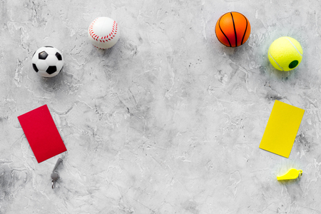 Sport judging concept. Soccer referee. Tactic plan for game, football ball, red and yellow cards, whistle on stone background top view copy space Stock Photo