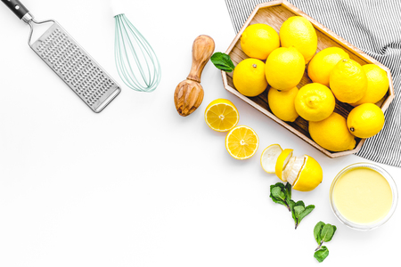Home kitchen table with yellow lemons for cooking citrus curd white background top view mock-up