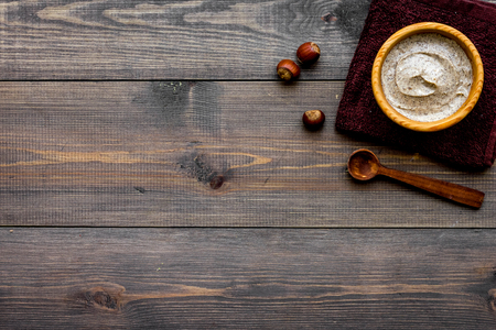 organic scrub with hazelnut for homemade spa on wooden background top view mockup