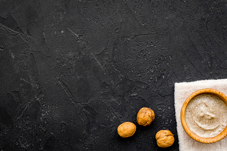organic scrub with walnut for homemade spa on black background top view mockup Stock Photo