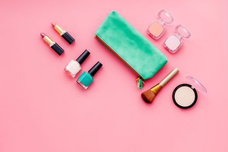 Women desk with decorative cosmetics for make up on pink background flat lay space for text Foto de archivo
