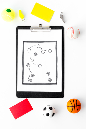 Sport judging concept. Basketball referee. Tactic plan for game, football ball, red and yellow cards, whistle on white background top view copy space