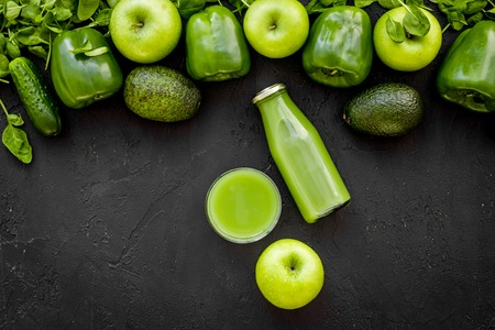 Fitness greeny drink with vegetables on dark background top view mock-up