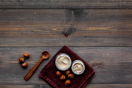 Beauty set with natural hazelnut scrub for spa on wooden background top view mockup